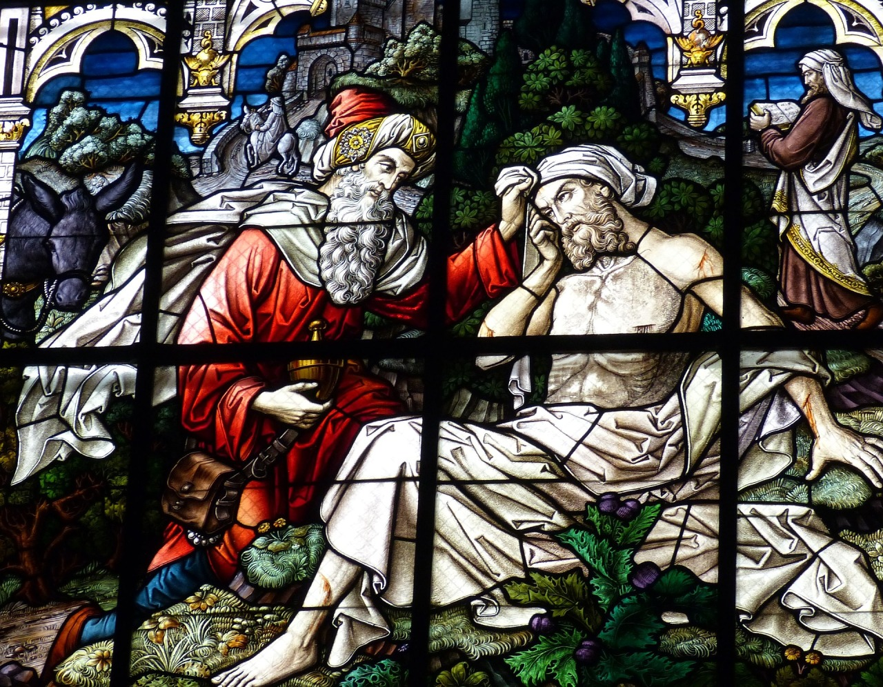 Stained glass window image of Good Samaritan