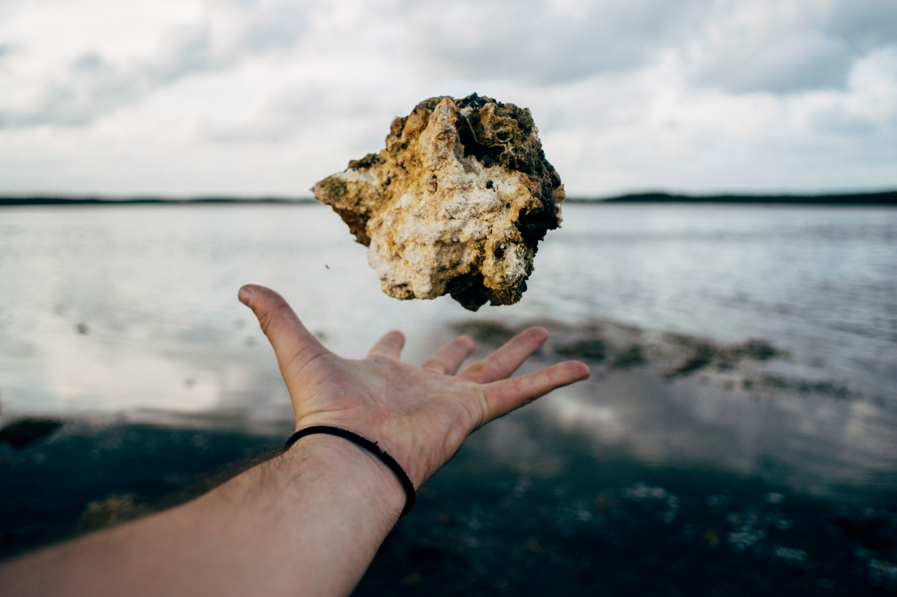 Hand tossing a rock