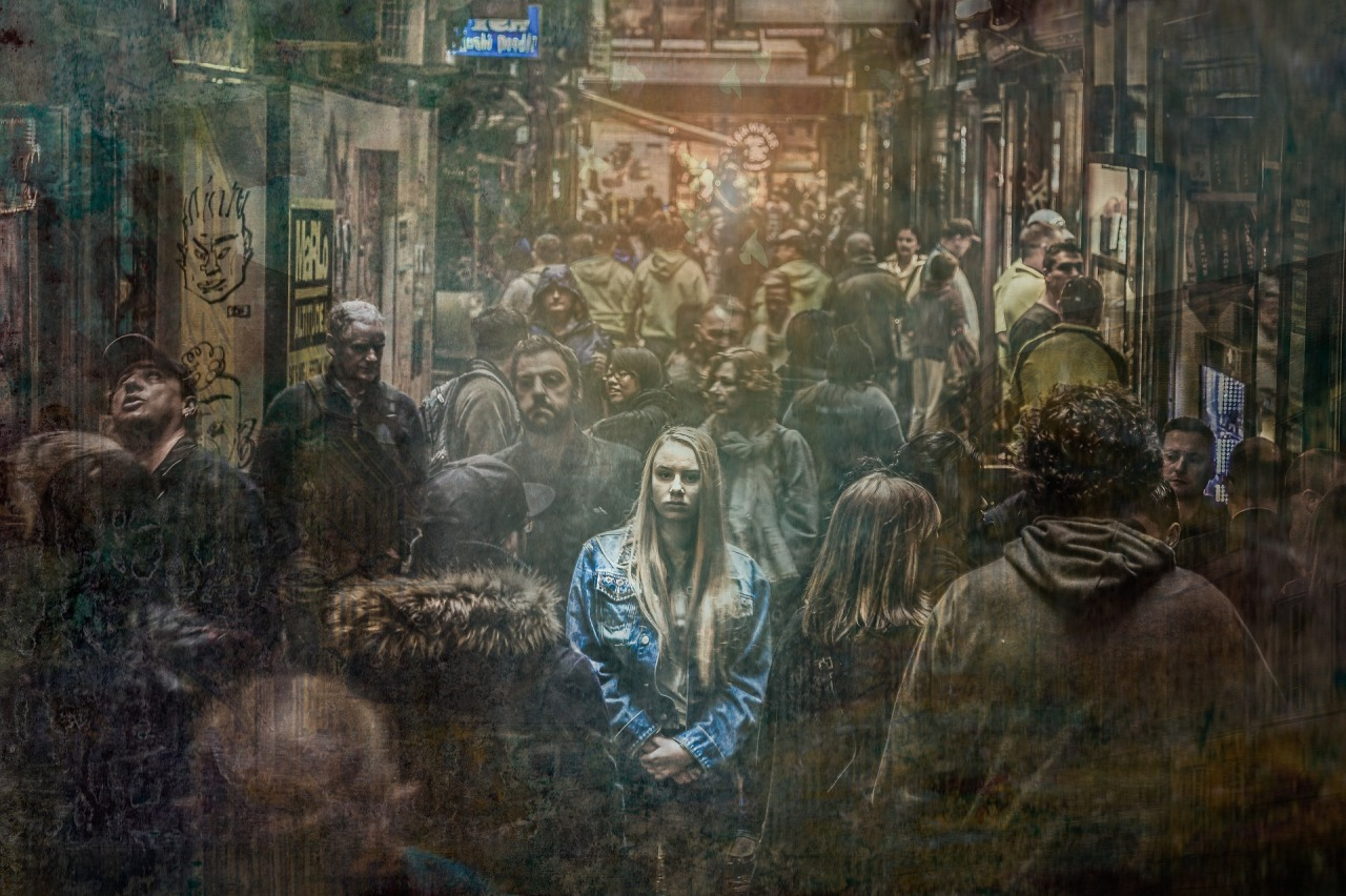 Woman in busy street surrounded by people