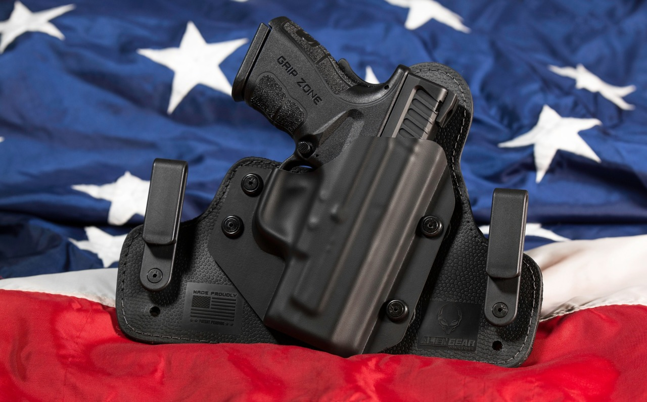 Handgun in holster on American flag