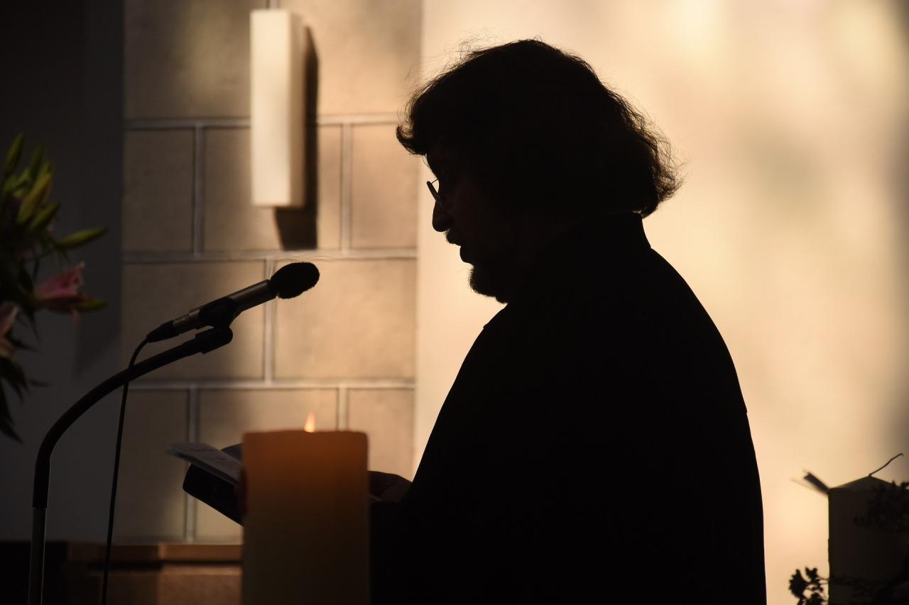 Silhouette of a pastor delivering a sermon