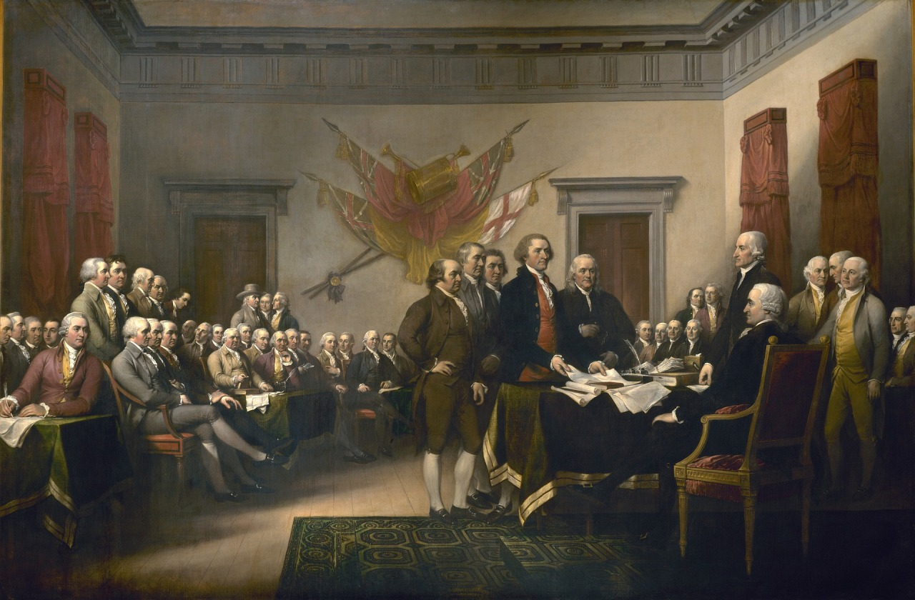 men signing the Declaration of Independence in a large room